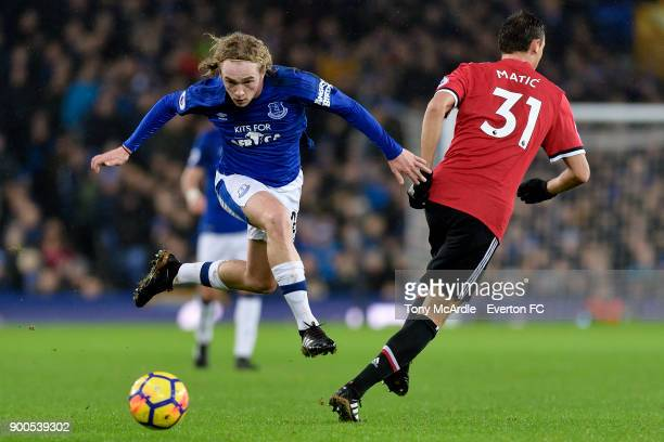 Tom Davies of Everton skips past Nemanja Matic during the Premier League match between Everton and Manchester United at Goodison Park on January 1...