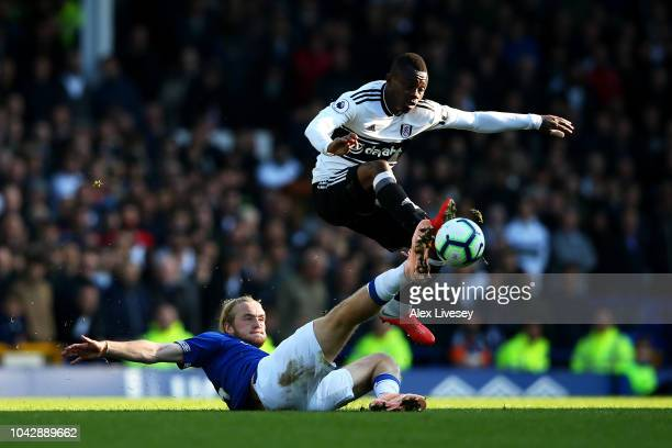 Tom Davies of Everton slides in to tackle Jean Michael Seri of Fulham during the Premier League match between Everton FC and Fulham FC at Goodison...