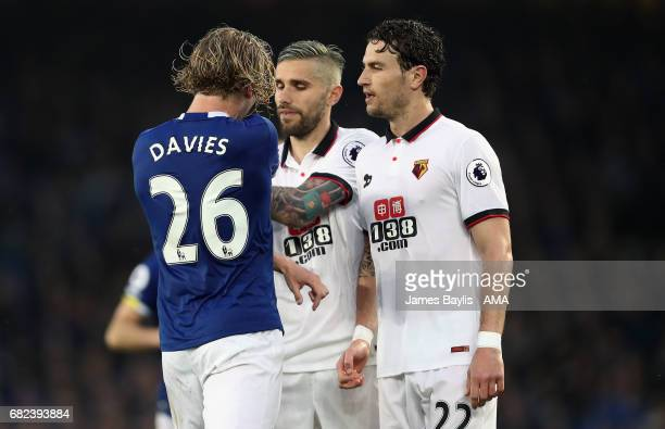 Tom Davies of Everton squares up to Darryl Janmaat of Watford during the Premier League match between Everton and Watford at Goodison Park on May 12...