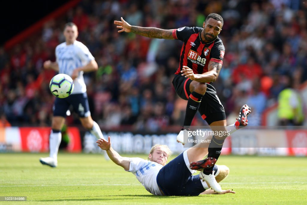 Tom Davies of Everton tackles Callum Wilson of AFC Bournemouth during the Premier League match between AFC Bournemouth and Everton FC at Vitality Stadium on August 25, 2018 in Bournemouth, United Kingdom.