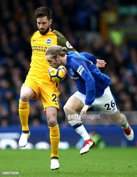 Tom Davies of Everton wins a header over Davy Propper of Brighton and Hove Albion during the Premier League match between Everton and Brighton and...