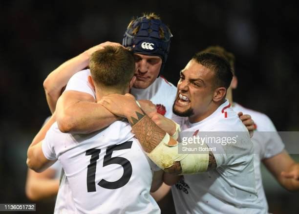 Tom De Glanville of England is congratulated by team mates Kai Owen and James Scott after scoring during the Under 20 Six Nations match between...
