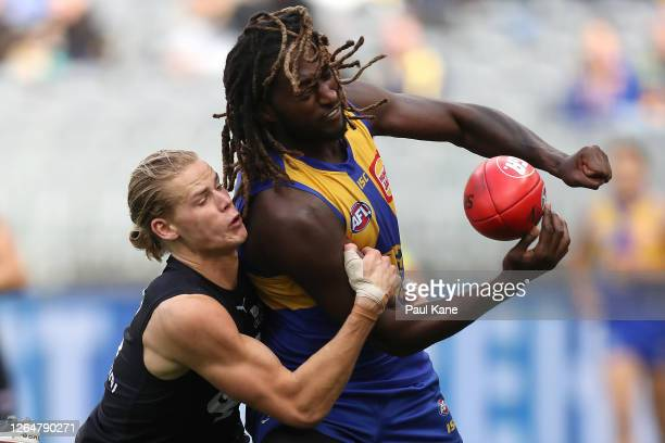Tom De Koning of the Blues tackles Nic Naitanui of the Eagles during the round 11 AFL match between the West Coast Eagles and the Carlton Blues at...