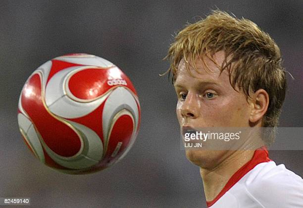 Tom De Mul of Belgium eyes the ball during their 2008 Beijing Olympic Games men's semifinal football match against Nigeria at the Shanghai Stadium on...