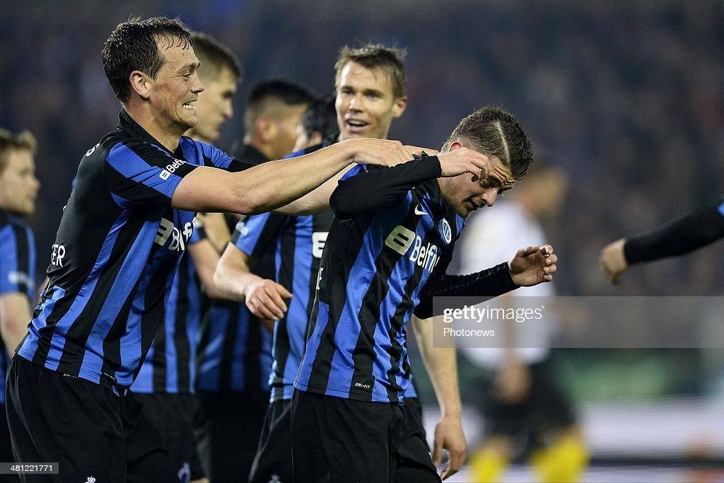 Tom De Sutter of Club Brugge celebrates scoring a goal with team-mate Maxime Lestienne of Club Brugge during the Jupiler Pro League Play-Off 1 match between Club Brugge and Sporting Lokeren on March 28, 2014 in the Jan Breydel Stadium in Brugge, Belgium.