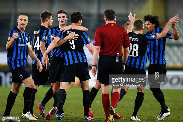 Tom De Sutter of Club Brugge celebrates scoring his teams first goal of the game with team mates during the UEFA Europa League Round of 16 1st leg...