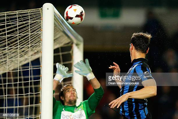 Tom De Sutter of Club Brugge sees his header come back of the crossbar as goalkeeper Laszlo Koteles of Racing Genk can only watch during the Jupiler...