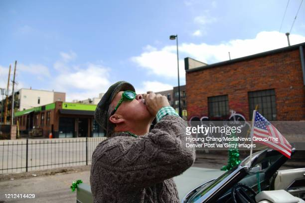 Tom Dea of Denver is celebrating St Patricks Day with friends at the empty parking of Lower Downtown in Denver Colorado on Saturday March 14 2020...