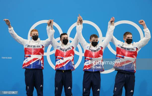 Tom Dean, James Guy, Matthew Richards and Duncan Scott of Team Great Britain celebrate during the medal ceremony for the Men's 4 x 200m Freestyle...