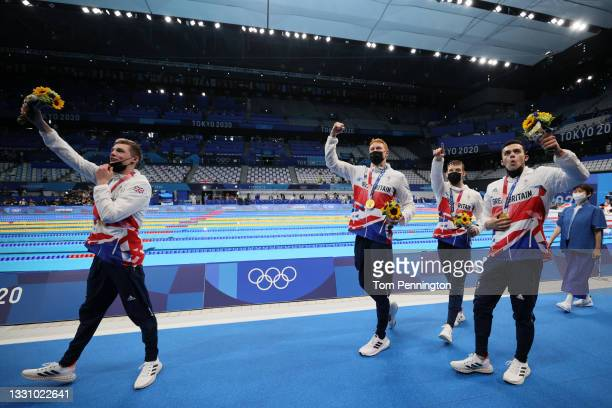 Tom Dean, James Guy, Matthew Richards and Duncan Scott of Team Great Britain celebrate with their gold medals during the medal ceremony for the Men's...