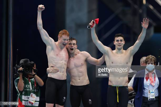 Tom Dean, Matthew Richards and James Guy of Team Great Britain celebrate after winning the gold medal in the Men's 4 x 200m Freestyle Relay Final on...