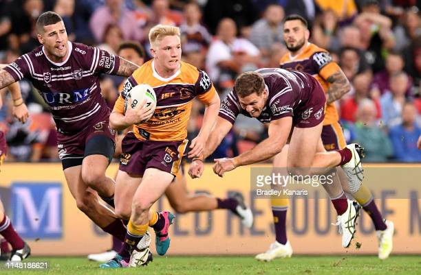 Tom Dearden of the Broncos breaks away from the defence during the round nine NRL match between the Sea Eagles and Broncos at Suncorp Stadium on May...