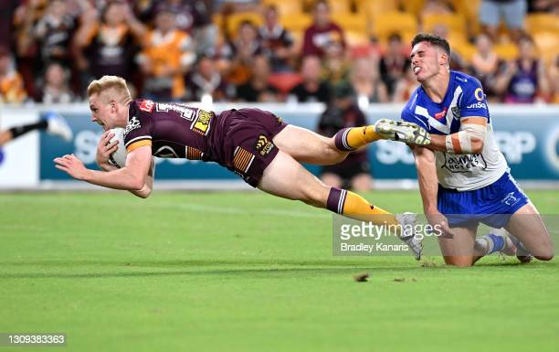 Tom Dearden of the Broncos scores a try during the round three NRL match between the Brisbane Broncos and the Canterbury Bulldogs at Suncorp Stadium...