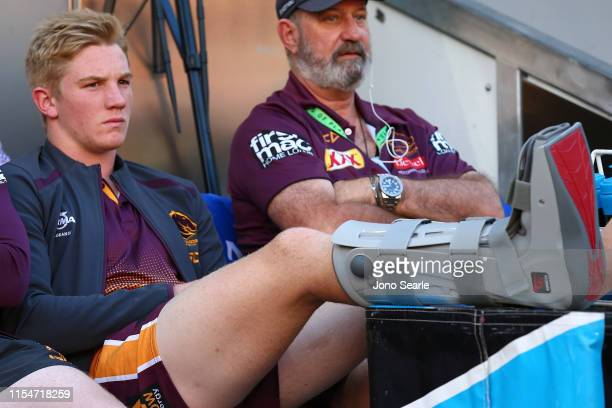Tom Dearden of the Broncos sits on the bench injured during the round 13 NRL match between the Brisbane Broncos and the Gold Coast Titans at Suncorp...
