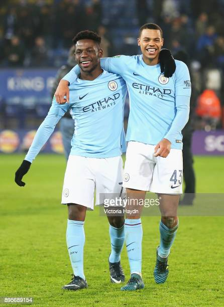 Tom DeleBashiru and Lukas Nmecha of Manchester City celebrate penalty shoot out victory after the Carabao Cup QuarterFinal match between Leicester...