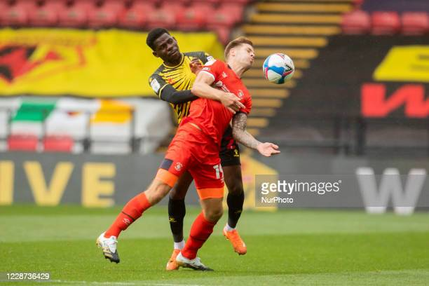 Tom DeleBashiru of Watford and James Collins of Luton Town during the Sky Bet Championship match between Watford and Luton Town at Vicarage Road...