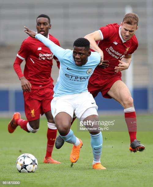 Tom DeleBasiru of Manchester City and Herbie Kane of Liverpool during the UEFA Youth League QuarterFinal at Manchester City Football Academy on March...