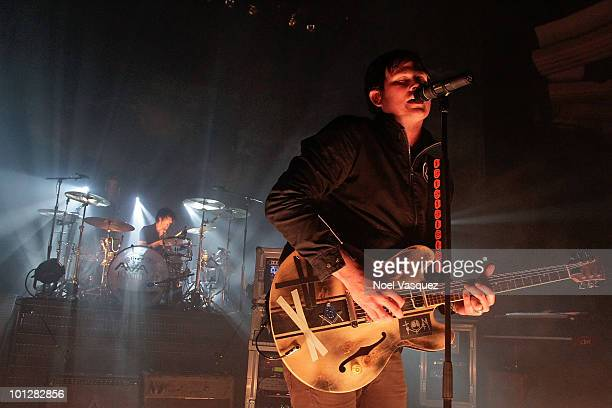 Tom DeLonge and Atom Willard of Angels And Airwaves perform at The Hollywood Palladium on May 29, 2010 in Hollywood, California.