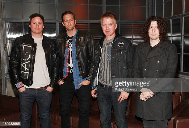 Tom DeLonge David Kennedy Matt Wachter and Ilan Rubin of the band 'Angels And Airwaves' pose for photos during a taping of Fuse's 'Hoppus on Music'...