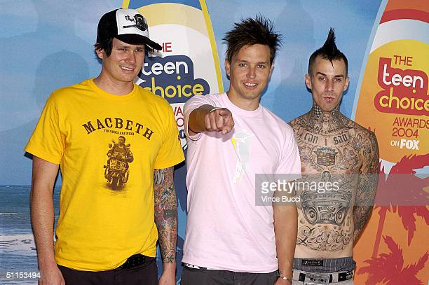 Tom DeLonge, Mark Hoppus and Travis Barker of Blink 182 pose backstage at The 2004 Teen Choice Awards held at Universal Amphitheater on August 8,...