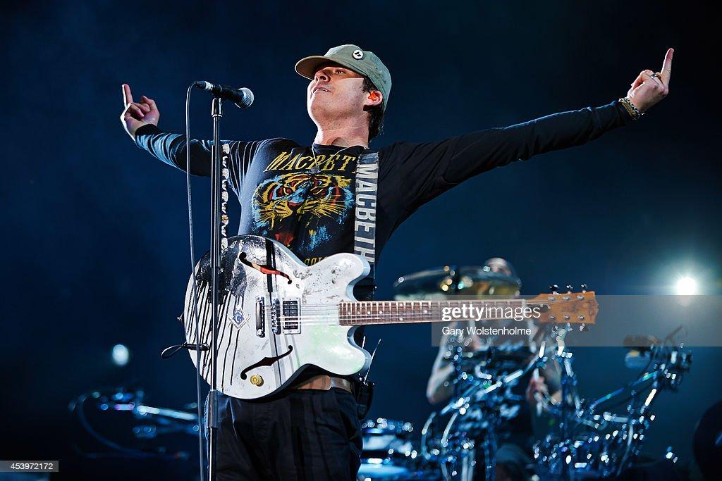 Tom DeLonge of Blink 182 performs on stage at Leeds Festival at Bramham Park on August 22, 2014 in Leeds, United Kingdom.