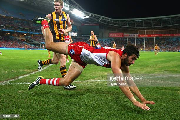 Tom Derickx of the Swans dives over the boundary line during the round eight AFL match between the Sydney Swans and the Hawthorn Hawks at ANZ Stadium...