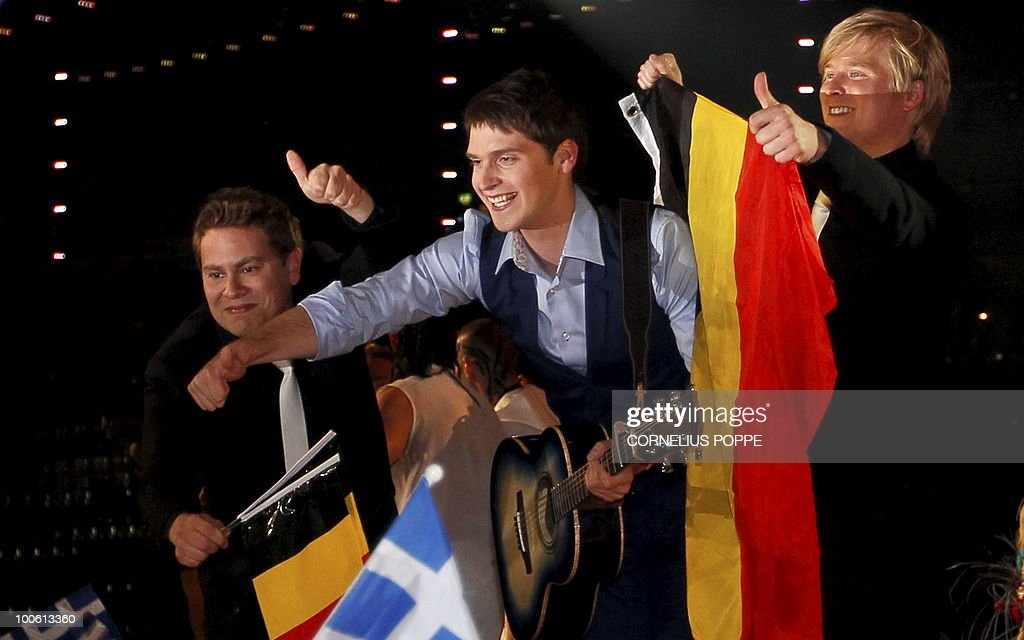 Tom Dice (C) from from Belgium celebrates after qualifying for the final Eurovision Song Contest in Telenor Arena in Baerum, Norway, on May 25, 2010. The 55th Eurovision Song Contest finale will take place on May 29 in the Telenor Arena in Oslo, after Norwegian Alexander Rydbak took the top prize in Moscow last year with his song 'Fairytale'. AFP PHOTO/SCANPIX/Cornelius Poppe ==NORWAY
