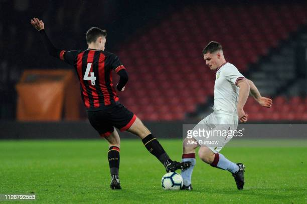 Tom Dinsmore of AFC Bournemouth battles for possession with Jake Walker of Aston Villa during the FA Youth Cup Fifth Round Match between AFC...