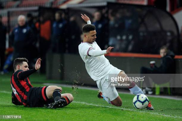 Tom Dinsmore of AFC Bournemouth tackles Bradley Burton of Aston Villa during the FA Youth Cup Fifth Round Match between AFC Bournemouth U18 and Aston...