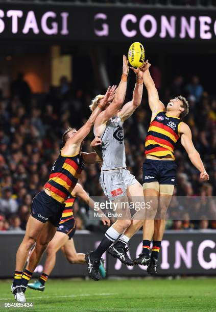 Tom Doedee of the Adelaide Crows spoils Andrew Phillips of the Blues during the round seven AFL match between the Adelaide Crows and the Carlton...