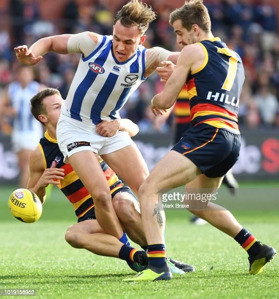 Tom Doedee of the Adelaide Crows tackles Ryan Clarke of the Kangaroos with help from Jordan Gallucci of the Adelaide Crows during the round 22 AFL...