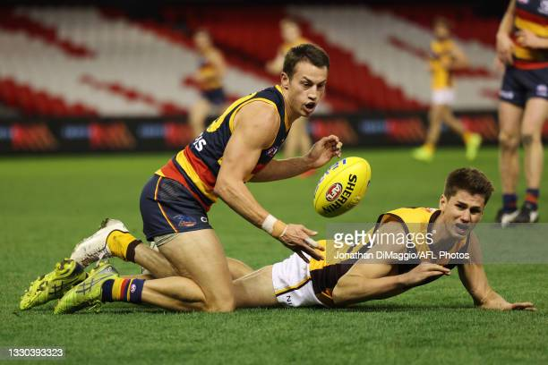 Tom Doedee of the Crows and Daniel Howe of the Hawks contest for the ball during the round 20 AFL match between Adelaide Crows and Hawthorn Hawks at...