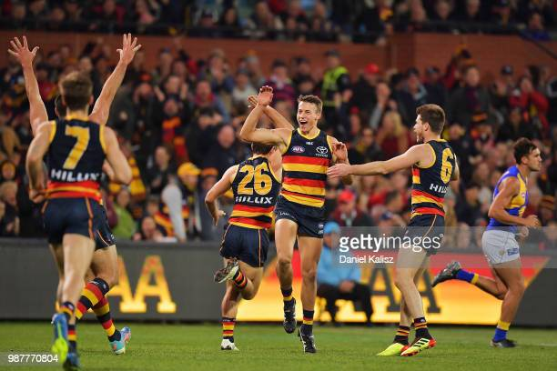 Tom Doedee of the Crows celebrates after kicking a goal during the round 15 AFL match between the Adelaide Crows and the West Coast Eagles at...