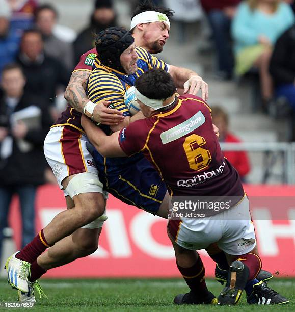 Tom Donnelly of Otago is wrapped up by the Southland defence during the round seven ITM Cup match between Otago and Southland at Forsyth Barr Stadium...