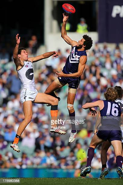 Tom Downie of the Giants and Zac Clarke of the Dockers contest the ruck during the round 20 AFL match between the Fremantle Dockers and the Greater...