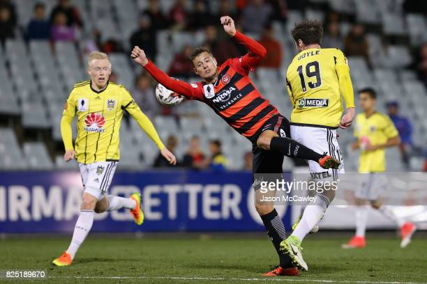 Tom Doyle of the Phoenix and Oriol Riera of the Wanderers compete for the ball during the FFA Cup round of 32 match between the Western Sydney...