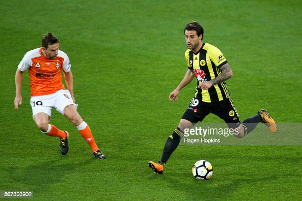 Tom Doyle of the Phoenix looks to evade Jack Hingert of Brisbane during the round four ALeague match between the Wellington Phoenix and the Brisbane...