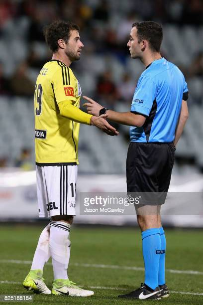 Tom Doyle of the Phoenix speaks to Referee Chris Kavanagh during the FFA Cup round of 32 match between the Western Sydney Wanderers and the...