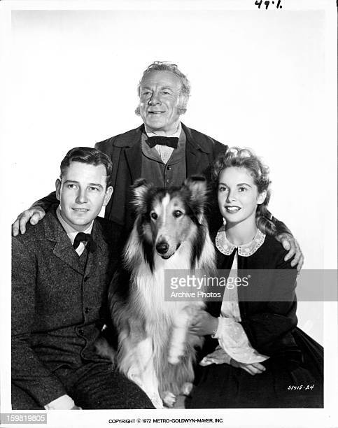 Tom Drake Edmund Gwenn Janet Leigh and Lassie pose for publicity portrait for the film 'Hills Of Home' 1948