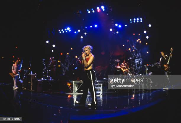 Tom Dumont, Gwen Stefani, Adrian Young, and Tony Kanal of No Doubt perform at Shoreline Amphitheatre on May 30, 1997 in Mountain View, California.