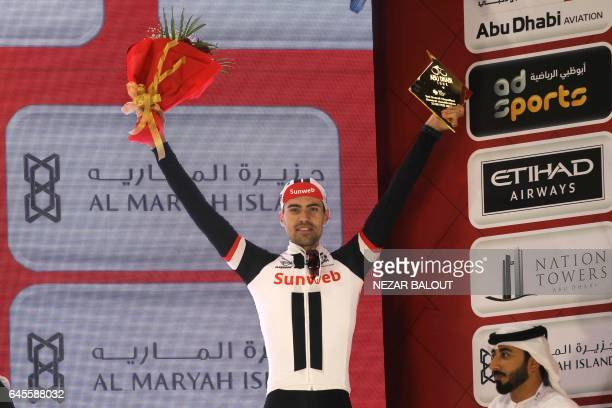 Tom Dumoulin celebrates on stage at the end of Yas Island stage of the Tour of Abu Dhabi on February 26 2017 / AFP / NEZAR BALOUT