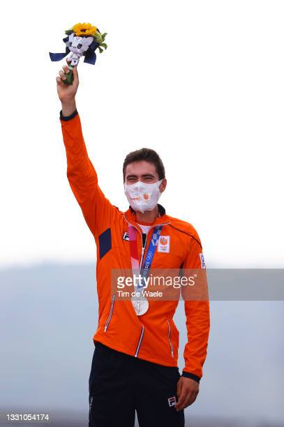 Tom Dumoulin of Team Netherlands poses with the silver medal after the Men's Individual time trial on day five of the Tokyo 2020 Olympic Games at...
