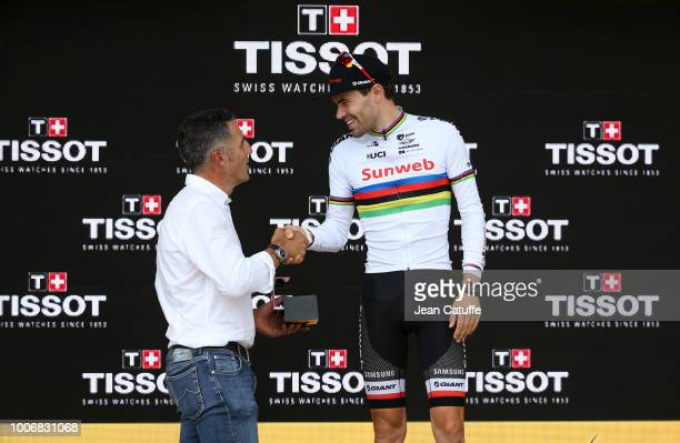 Tom Dumoulin of the Netherlands and Team Sunweb receives from former Tour de France winner Miguel Indurain a watch Tissot for winning the time trial...