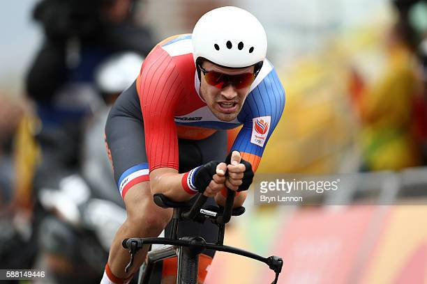 Tom Dumoulin of the Netherlands crosses the finish line in the Cycling Road Men's Individual Time Trial on Day 5 of the Rio 2016 Olympic Games at...