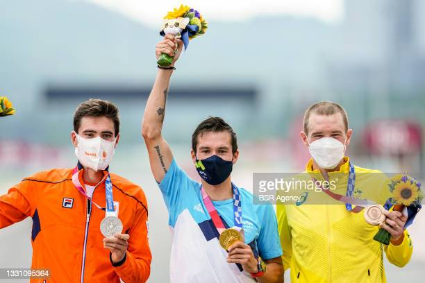Tom Dumoulin of the Netherlands with his silver medal, Primoz Roglic of Slovenia with his gold medal and Rohan Dennis of Australia with his bronze...