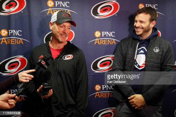 Tom Dundon owner of the Carolina Hurricanes and Charlie Ebersol of the Alliance of American Football speak to media before an NHL game against the...