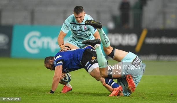 Tom Dunn of Bath Rugby is tackled by Lewis Ludlow of Gloucester Rugby during the Gallagher Premiership Rugby match between Bath Rugby and Gloucester...