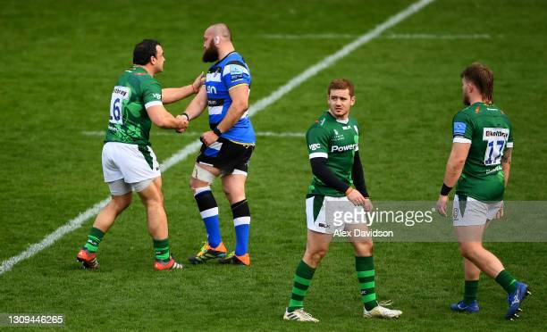 Tom Dunn of Bath shakes hands with Agustin Creevy of London Irish after being given a red card for a high arm during the Gallagher Premiership Rugby...