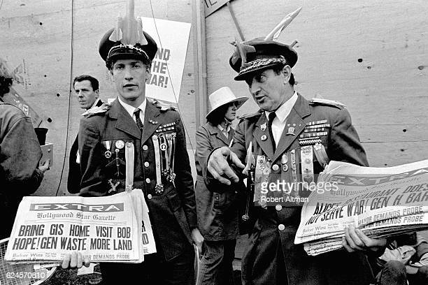 Tom Dunphy as Gen Waste More Land and Calypso Joe as Gen Hershey Bar show newspapers of and during an AntiWar Moratorium on April 16 1969 in...