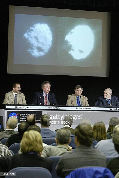 Tom Duxbury Stardust project manager is flanked by NASA's director of solar systems exploration Orlando Figueroa Stardust principal investigator Don...